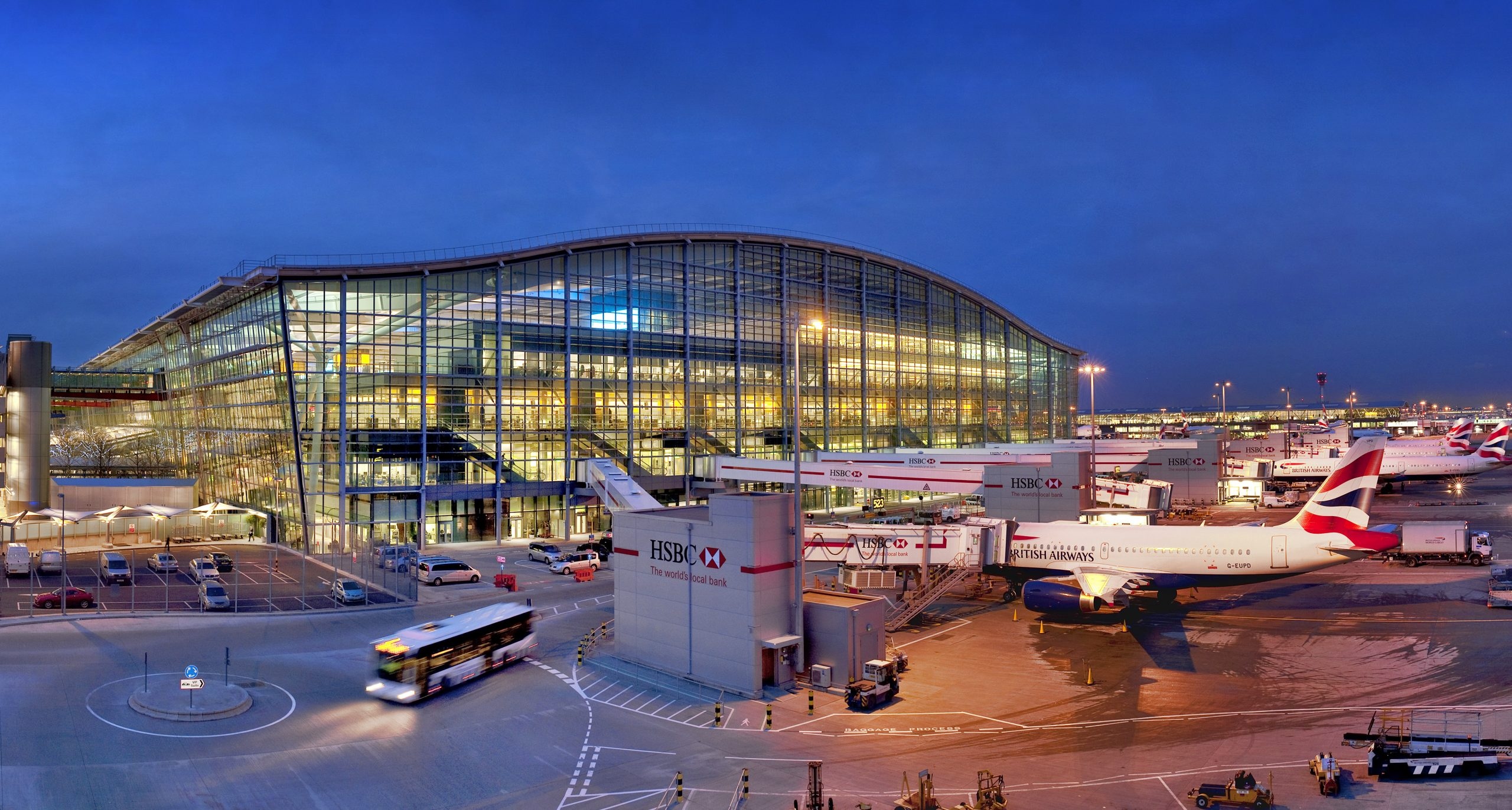 Heathrow Airport, Terminal 5A, main terminal building (southern elevation) and apron area at dusk (seen from Energy Centre roof), March 2010. Image Ref CHE06982d NW